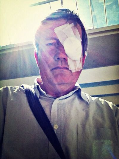Supersize Yourself With Whitewall One Eyed man with bandage over one eye