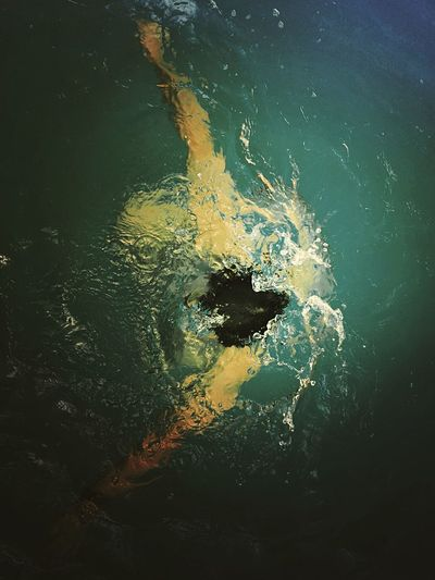 High angle view of person swimming in water