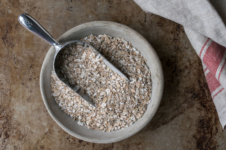 A bowl of oats Food And Drink Food Healthy Eating Bowl Directly Above Oats - Food No People Breakfast Cereal Oatmeal High Angle View Uncooked Bulk Grain Cereal Scoop Macro Isolated Nobody Ingredient