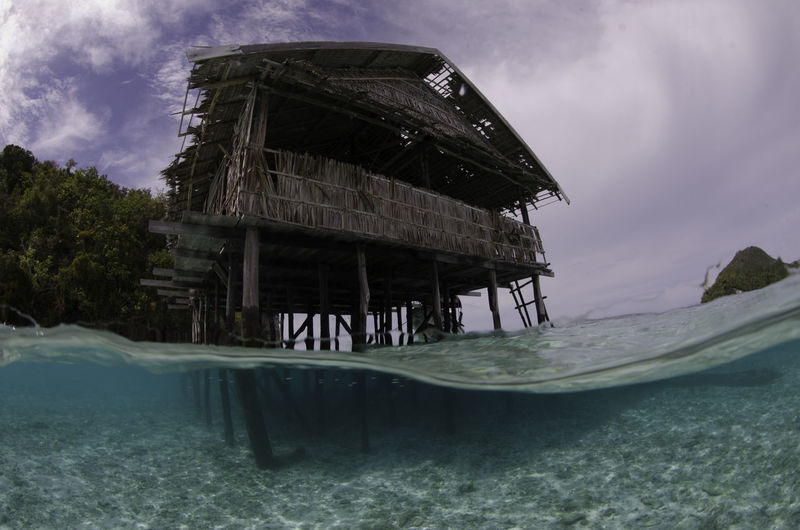 Abandon house in water Stilts Abandoned Architecture Built Structure Day Nature No People Outdoors Sea Sky Stilt Water