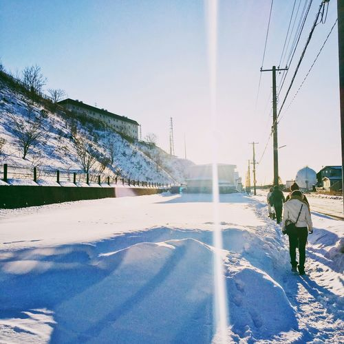 The City Light Snow Winter Cold Temperature Day Outdoors Sky Real People Nature One Person Men Backlight Backlit Sunset Shadows & Lights