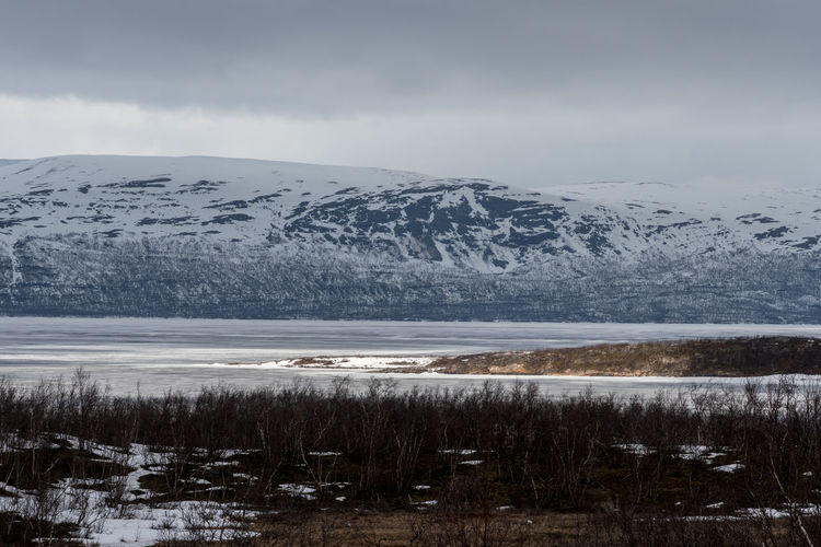 Island in the sun Abisko Beauty In Nature Cold Temperature Day Frozen Ice Iceberg Lake Landscape Mountain Nature No People Outdoors Scenics Sky Snow Sweden Tranquil Scene Tranquility Water Winter