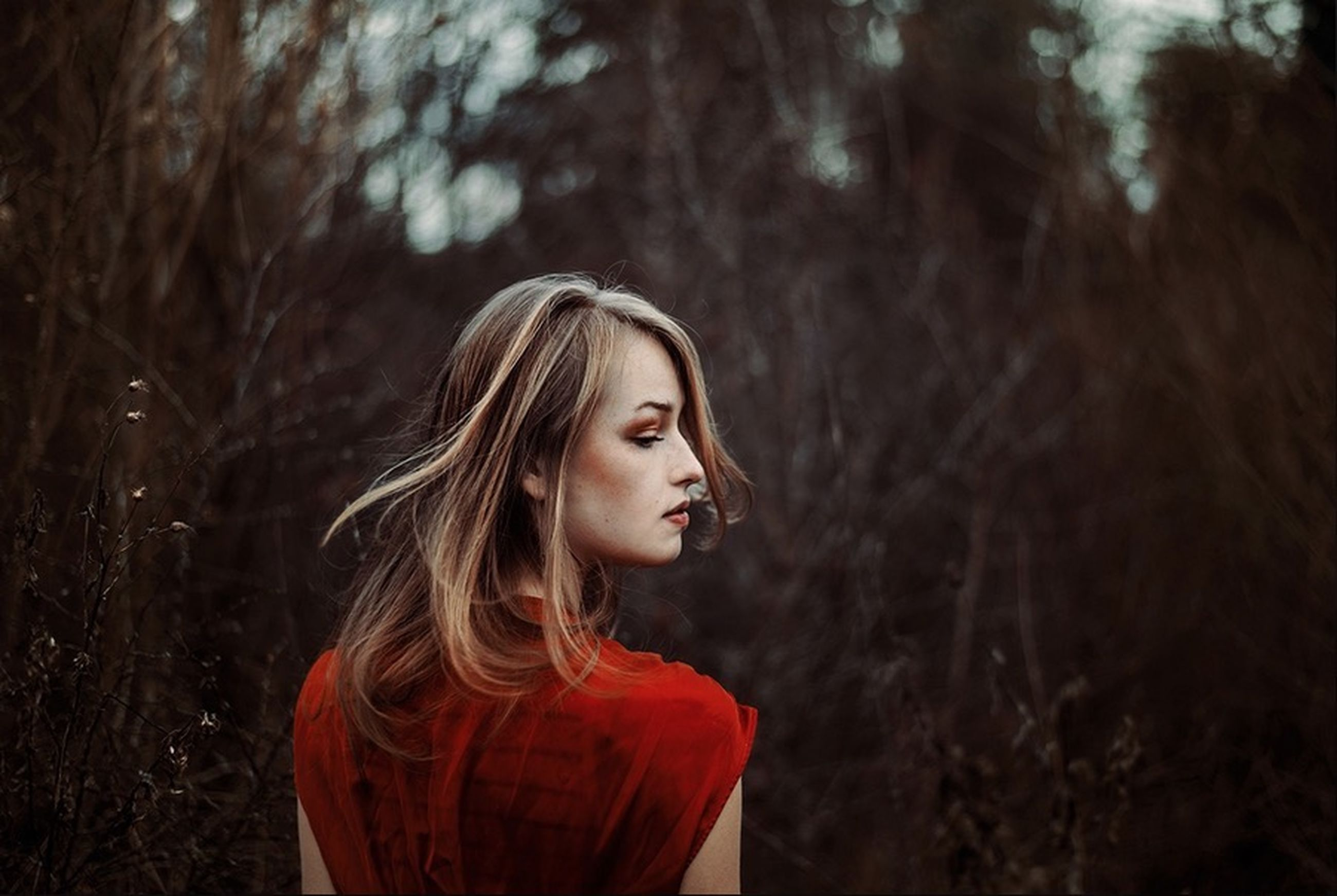 young adult, long hair, young women, lifestyles, person, leisure activity, looking at camera, portrait, forest, tree, front view, focus on foreground, brown hair, headshot, standing, casual clothing, waist up
