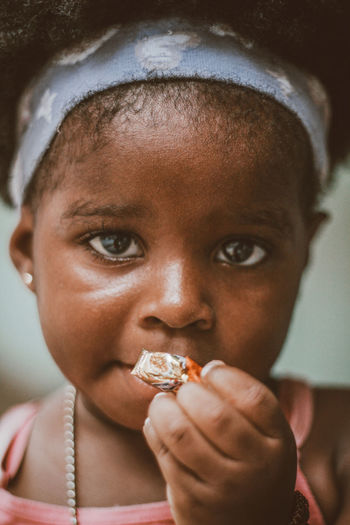 Close-up portrait of girl eating