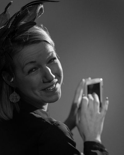 Portraits of a Young Woman - Acting Happy Portrait Of A Woman Press For Progress Black And White Photography Close-up Day Happiness Headshot Holding Human Hand Lifestyles One Person Portrait Portrait Photography Real People Smartphone Smiling Smiling Face Studio Shot Young Adult Young Woman