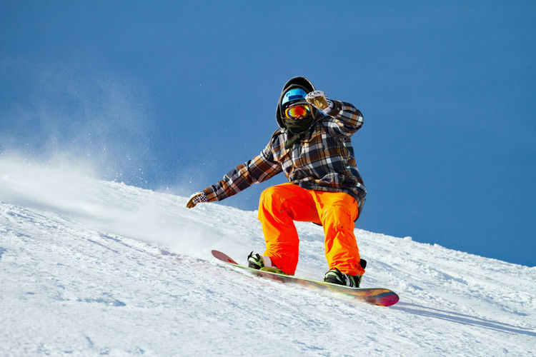 Low angle view of person snowboarding