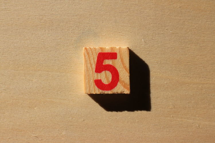 Close-up of number 5 on wood
