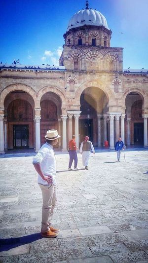 Tunis Algeria Sahara Man Lonely Mosque Architecture Mosque Mosquée Zitouna City Full Length Place Of Worship Dome History Architectural Column Sari Arch Ancient Palace Ancient Civilization Archaeology Old Ruin Civilization Visiting