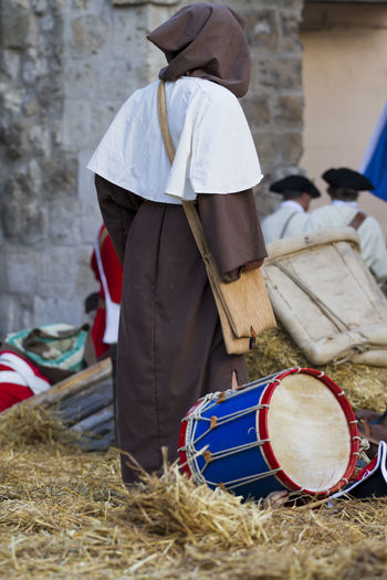Person Standing By Drum On Hay