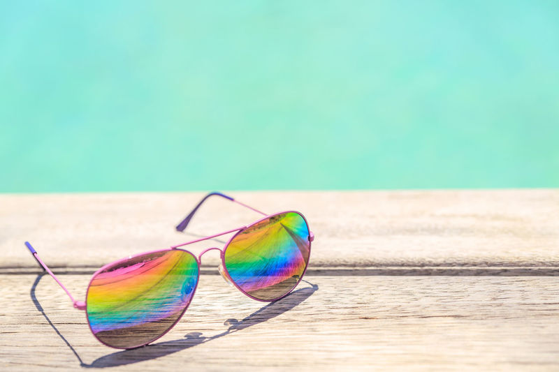 Colorful sunglasses lying on a wooden deck Bora Bora  Green Color Blue Colorful Decking Wood Reflections Reinbow Shadow Summer Sunglasses Water