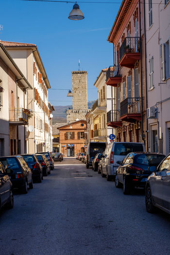 simple Italy Architecture Building Building Exterior Built Structure Car City Day Diminishing Perspective Direction House In A Row Land Vehicle Mode Of Transportation Motor Vehicle Nature Residential District Road Row House Sky Street The Way Forward Transportation