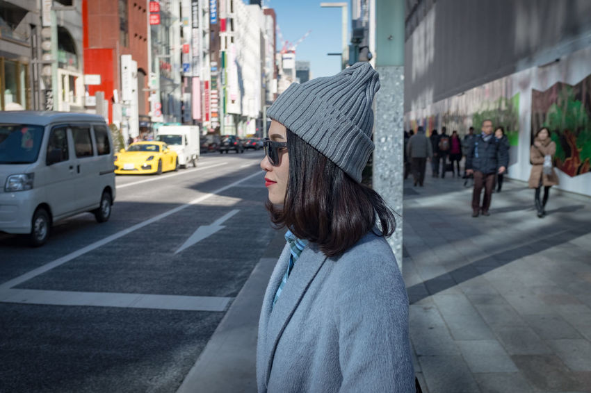 Ginza Tokyo Japan Japan Tokyo Architecture Car City City Life City Street Day Hairstyle Mode Of Transportation One Person Outdoors Real People Road Side View Street Tourism Transportation Women