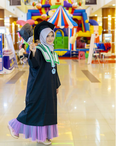 graduation day Looking At Camera Happiness One Person Smiling Real People Lifestyles Portrait Emotion Leisure Activity Front View Incidental People Standing Women Indoors  Focus On Foreground Clothing Three Quarter Length Child Hairstyle Innocence A New Beginning Moments Of Happiness International Women's Day 2019