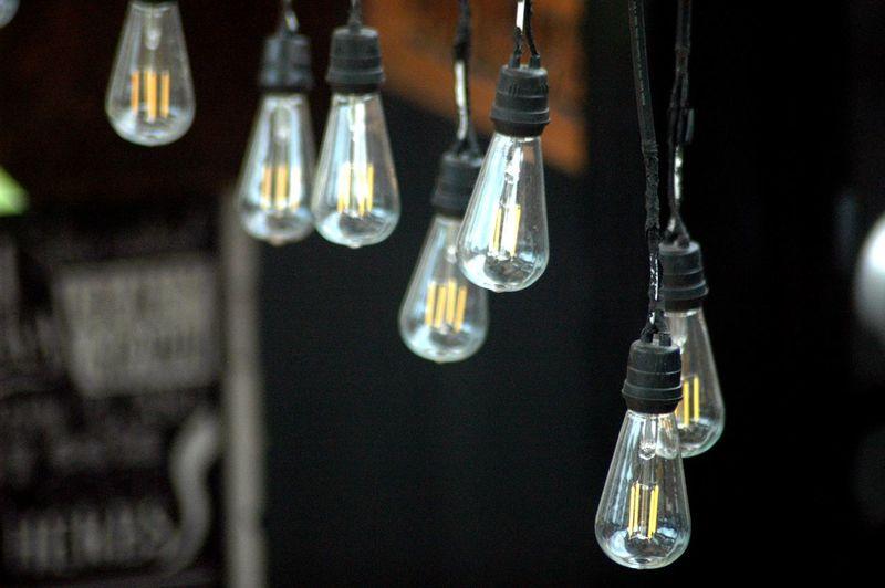 Close-Up Of Light Bulbs Hanging Outdoors