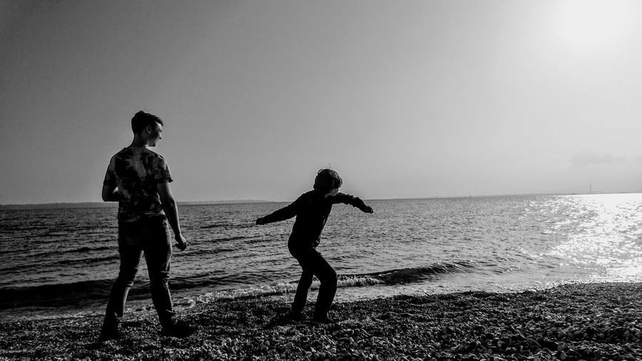 Brothers Brothers Blackandwhite Water Sea Throwing Stones In The Water Filter Companion Water Sea Beach Full Length Togetherness Standing