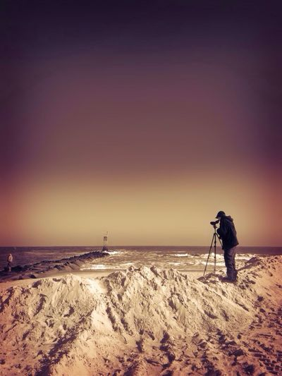 Person Photographing Beach