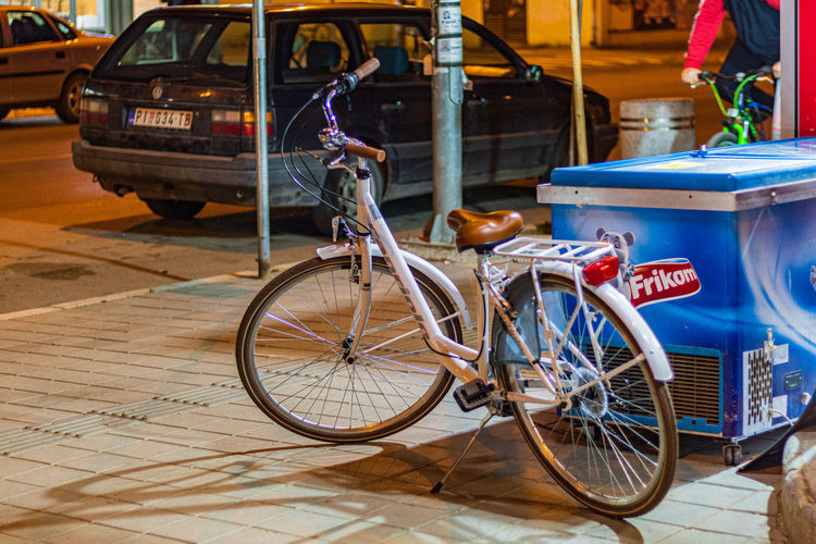 White bicycle Night Bicycle White Bike Street Shop Street Photography White Bicycle Bike Traffic Streets Of Pirot Illuminated Road Serbia Car Lights Bikes Pirot Man Riding A Bike Mode Of Transport White Transportation Mode Of Transportation City Land Vehicle Incidental People Architecture Real People Day Sidewalk One Person Motor Vehicle Footpath Focus On Foreground City Life Travel Outdoors Wheel The Street Photographer - 2019 EyeEm Awards