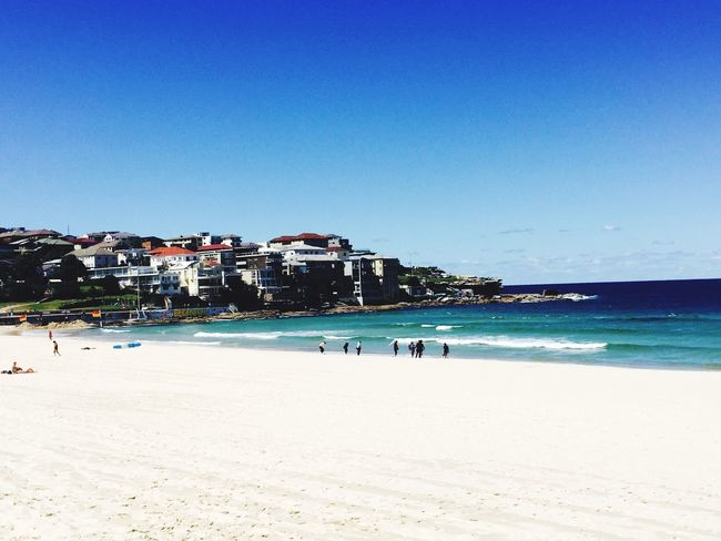 Beach Clear Sky Copy Space Blue Sea Sand Building Exterior Bondi Beach Blue Wave Architecture IPhoneography Love In Nature Water Summer Vacations Architecture Scenics Outdoors Tourism Day Nature People In The Background City Sky