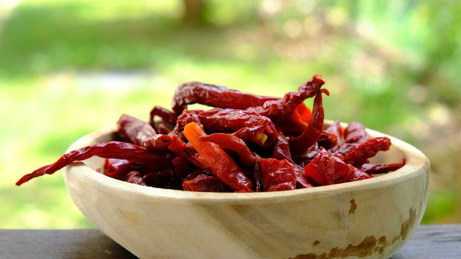 Close-up of red chili peppers in bowl on table
