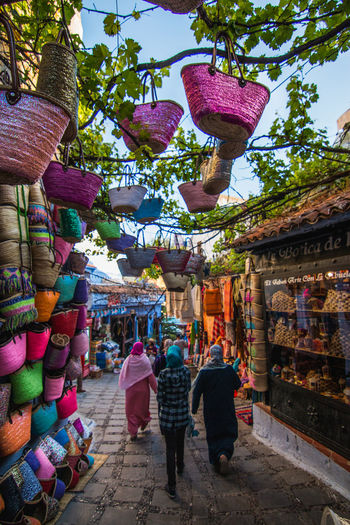Alleys of Chefchaouen Africa Alley Bag Blue Chefchaouen City Color Colorful Colors Day Hanging Light Mediterranean  Morocco Old Outdoors People Shopping Sky Street Travel Travel Destinations Tree Trees Urban