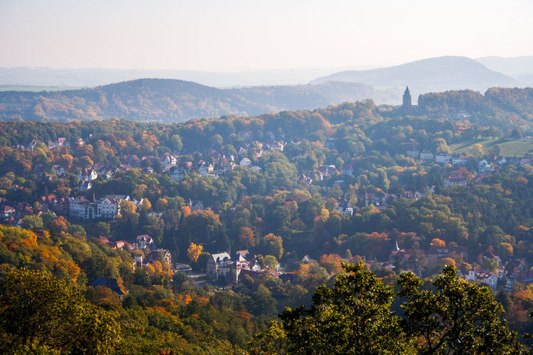 Aerial view of town and trees in autumn