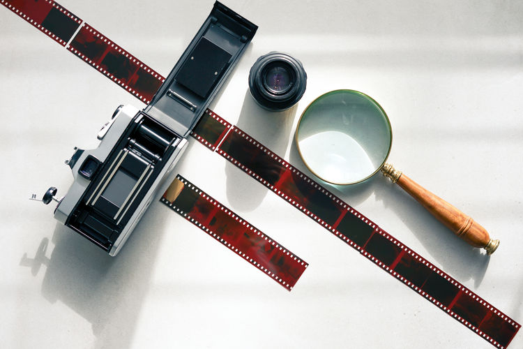 High angle view of camera on table against white background