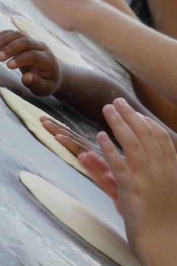 Cropped hands of children preparing food
