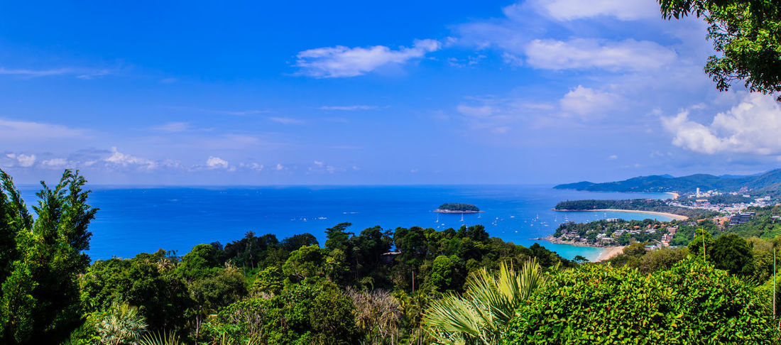 Beautiful seascape of turquoise ocean waves with boats, coastline and blue sky background from high aerial view point of Kata and Karon beaches in Phuket Thailand. Karon Beach, Phuket Karon Beach, Phuket, Thailand Kata Beach Kata Beach,Phuket Thailand Kata Beach Phuket, Thai Beauty In Nature Blue Blue Sky Cloud - Sky Day Growth Horizon Over Water Karon Karon Beach Karon View Point Karon Viewpoint Karonbeach Kata Noi Kata Noi Beach Landscape Mountain Nature No People Outdoors Plant Scenics Sea Seascape Seascape Skyscape Sky Tranquil Scene Tranquility Tree Turquoise Turquoise Sea Water
