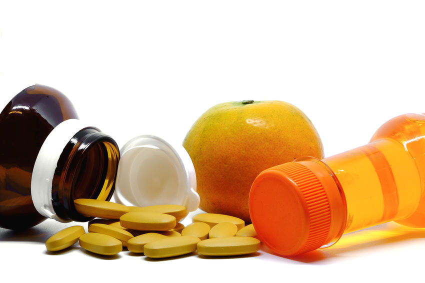 Beverage Orange Antibiotic Bottle Capsule Dose Food Food And Drink Freshness Fruit Healthcare And Medicine Healthy Eating Healthy Lifestyle Large Group Of Objects Medicine Nutritional Supplement PainKiller Pill Pill Bottle Prescription Medicine Sweet Vitamin Vitamin C Water White Background