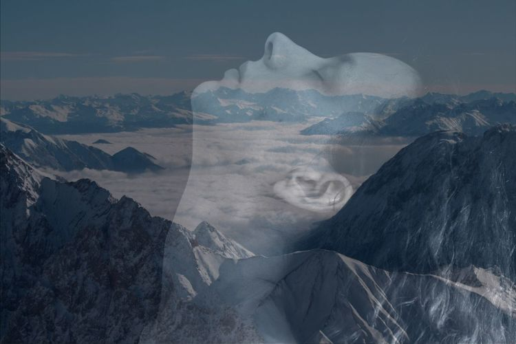 Double exposure image of woman and rock formation