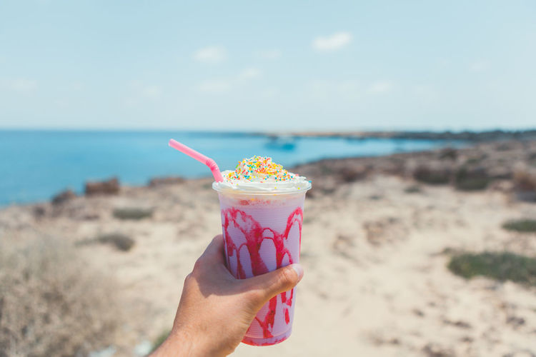 Strawberry Milkshake in the hand Adult Adults Only Beach Beach Holiday Day Drink Focus On Foreground Holding Horizon Over Water Human Hand Ice Cream Indulgence Nature One Person Outdoors People Refreshment Relaxation Sand Sea Sky Vacations Water Market Bestsellers 2017