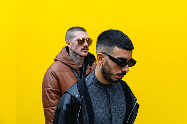 London Fashion Week Mens 2019 Redefining Menswear Yellow Glasses Sunglasses Fashion Young Adult Young Men Colored Background Lifestyles Yellow Background Waist Up Casual Clothing Facial Hair People Front View Two People Real People Standing Fashion Fashion Photography London Menswear Mensfashion Street Style British Culture