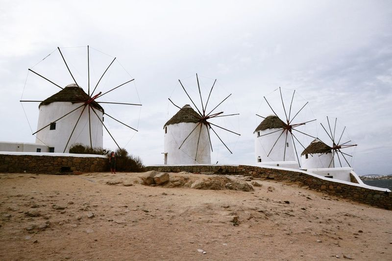 Windmills Alternative Energy Wind Power Sand Fuel And Power Generation Outdoors Wind Turbine Beach Day No People Built Structure Travel Destinations Sky Traditional Windmill Technology Sea Windmill Nature Mykonos The Week On EyeEm Architecture
