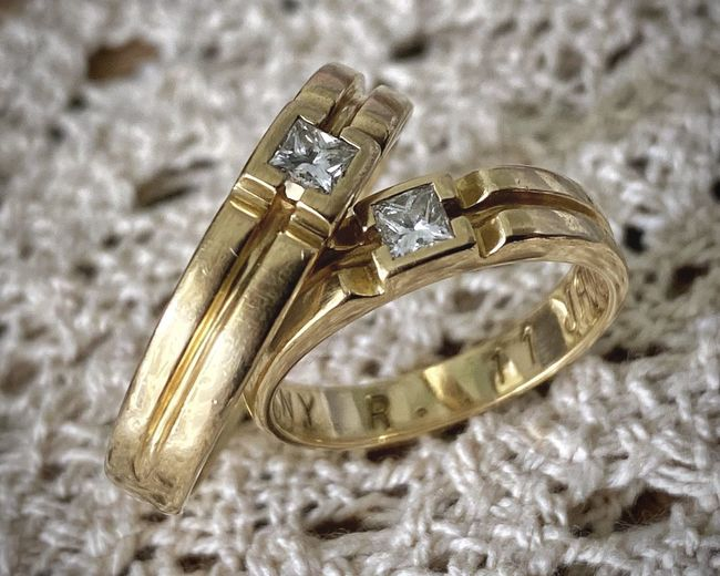 Close-up of wedding rings on metal