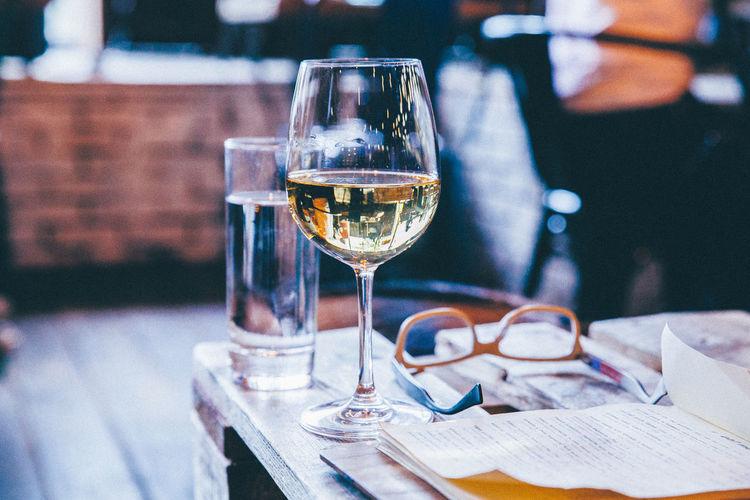 Close-Up Of Alcohol Glass Next To Eyeglasses