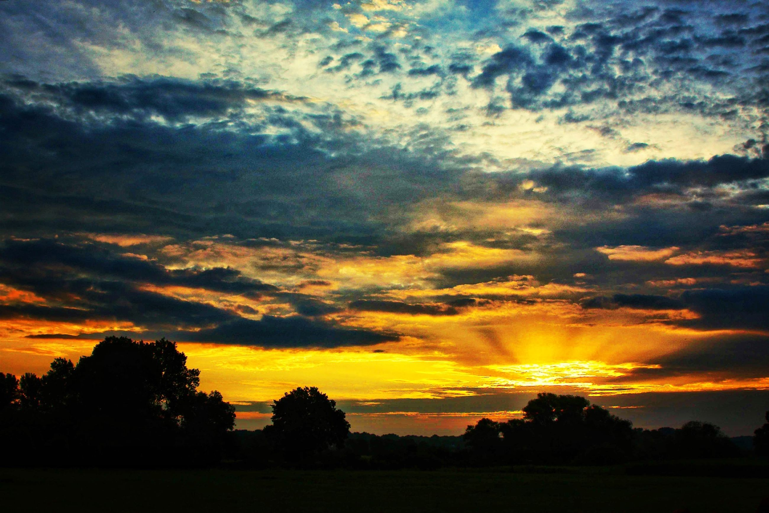 sunset, silhouette, sky, scenics, tranquil scene, beauty in nature, tranquility, cloud - sky, orange color, tree, idyllic, landscape, nature, dramatic sky, cloud, majestic, outdoors, moody sky, cloudy, dark