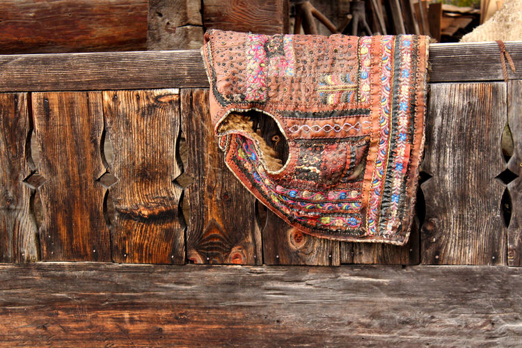 Wood - Material No People Art And Craft Indoors  Pattern Table Creativity Multi Colored Day Old Close-up Brown Still Life Craft Weathered Hanging Full Frame Choice Floral Pattern