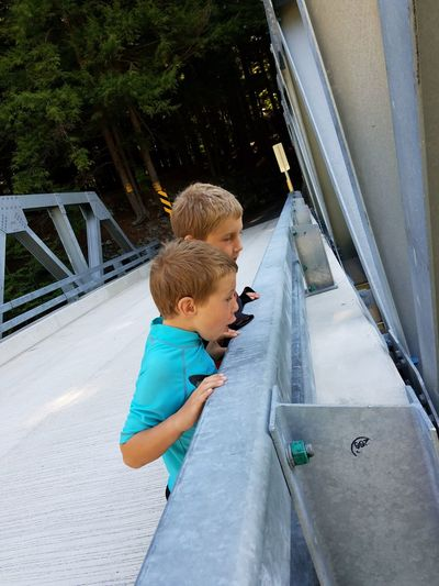 Two People Outdoors Bridge Metal Structure Road Boys Day Surprised Face Brothers