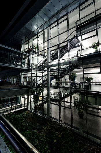 Architecture Glass - Material Built Structure Modern Transparent Building Exterior No People Plant Day City Window Outdoors Building Illuminated Nature Reflection Transportation Low Angle View Rail Transportation Glass Ceiling