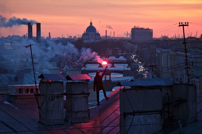 Self-portrait with torch on the rooftop at Fontanka river embankment. City City Cold Dusk Dusk In The City Evening Fire Roof Rooftop Rooftopping Self Portrait Selfie Selfportrait Signal Smoke Sunset Torch Twilight Winter