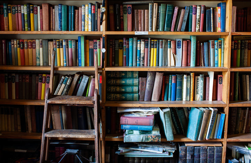 Books arranged on shelf