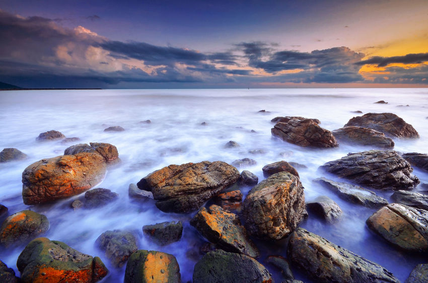 Nakhon Si Thammarat Thailand Beach Beauty In Nature Cloud - Sky Day Horizon Over Water Long Exposure Motion Nature No People Outdoors Pebble Beach Rock - Object Scenics Sea Sky Sunset Tranquil Scene Tranquility Water ทะเลแสนงาม นครศรีธรรมราช หาดหินงาม