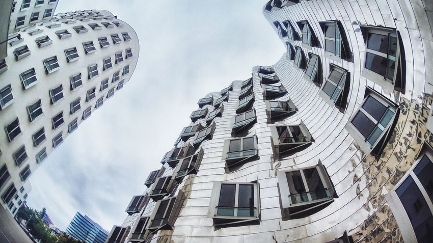 Frank Gehry Building Apartment Architecture Building Building Exterior Built Structure City City Life Cloud Cloud - Sky Cloudy Day Düsseldorf Fotostrasse Low Angle View Modern No People Office Building Outdoors Residential Building Sky Tall - High