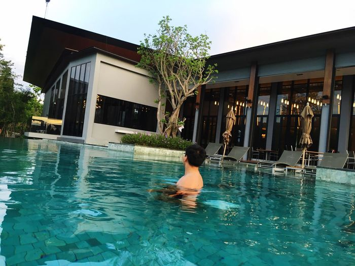 #swimming #Swimming Pool #dusit #dusitd2 #dusithotel #dusitthailand #relaxing #relax Building Exterior Architecture Water Built Structure Real People Swimming Pool One Person Adult Women Building Outdoors Leisure Activity Waterfront Pool Men Lifestyles Nature Day