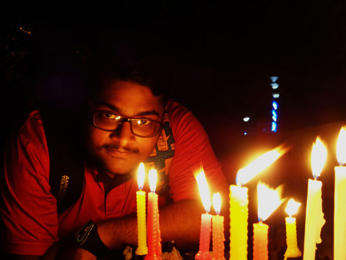Low light potrait..... Flame Candle Burning Night One Person Igniting Red Real People Heat - Temperature One Man Only Sohom Das