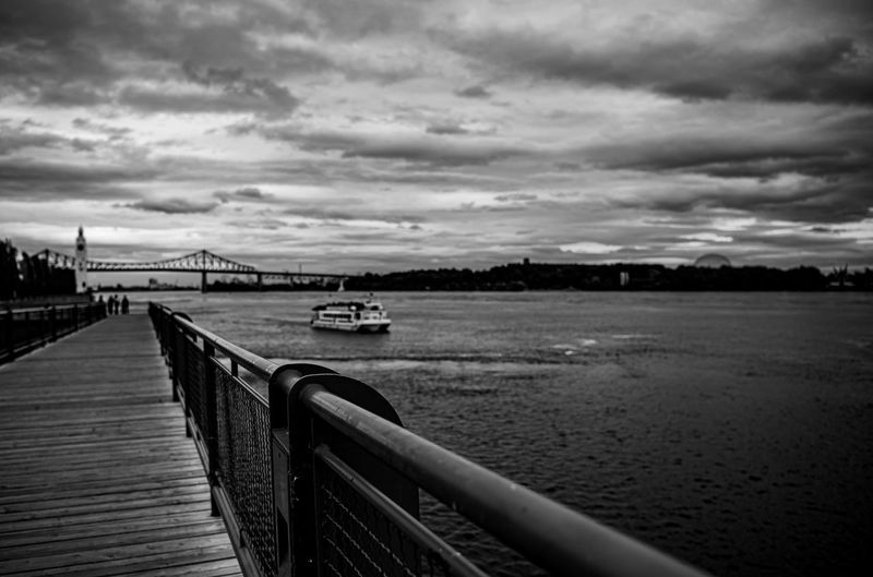Water Cloud - Sky Sky Nature Transportation Architecture Built Structure Scenics - Nature River Railing Beauty In Nature Nautical Vessel No People Connection Outdoors Bridge Tranquility Tranquil Scene Blackandwhite Old Port Of Montreal/Vieux-Port De Montréal Montreal, Canada Vintage Clock Tower White Wall