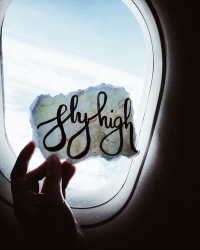 Fly High ✈️ Human Hand Text One Person Day Sky Indoors  Real People People Communication Airplane Angeli Bea Brush Calligraphy Lettering Paper Color Travel Fly High Flying High Best EyeEm Shot IPhoneography IPhone Iphoneonly Iphonephotography IPhone Photography