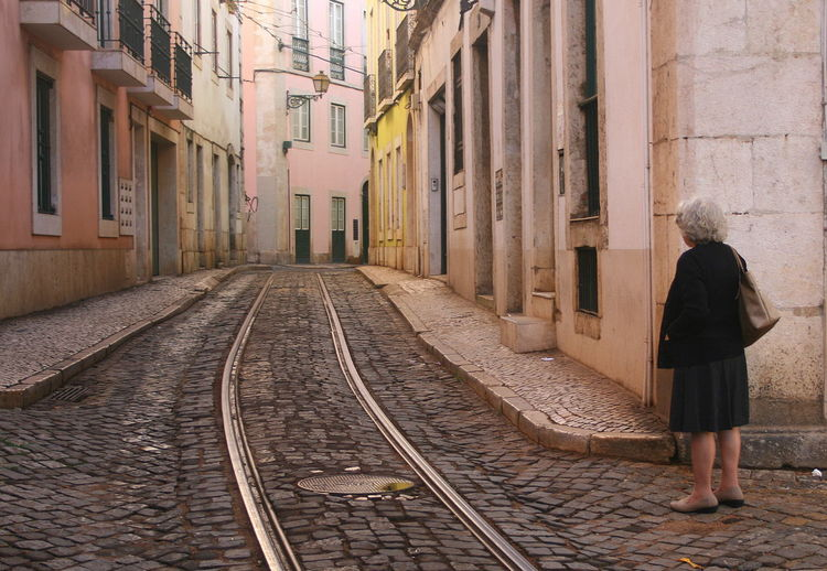 Adult Architecture Building Exterior Built Structure Day Full Length Lisboa Portugal Lisbon - Portugal Loneliness One Person Outdoors People Railroad Track Real People Rear View The Way Forward Tramway Rail Tramway Station Transportation Waiting Waiting For A Tramway Women