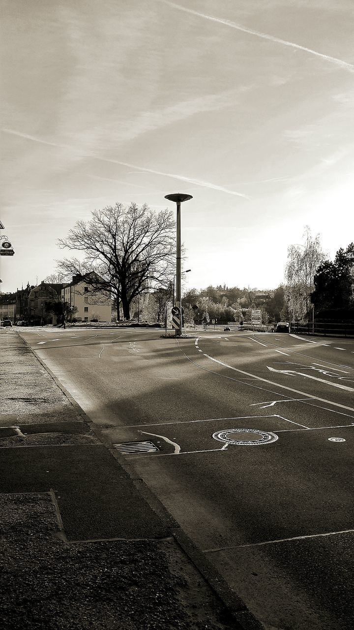 tree, bare tree, empty, road, outdoors, transportation, day, sky, cloud - sky, no people, road sign, nature, basketball - sport