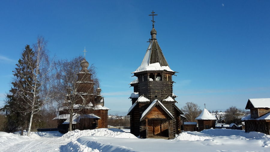 View of the open air museum in Suzdal', Russia Architecture Built Structure Building Exterior Cold Temperature Winter Building Sky Snow Religion Nature Belief Place Of Worship Tree Spirituality No People Day Clear Sky Plant Outdoors Spire  Churches Wooden Churches Open Air Museum Landmarks Cultural Landscape